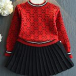 red two piece pleated skirt and sweater outfit