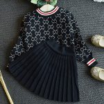the black two piece pleated skirt sweater outfit