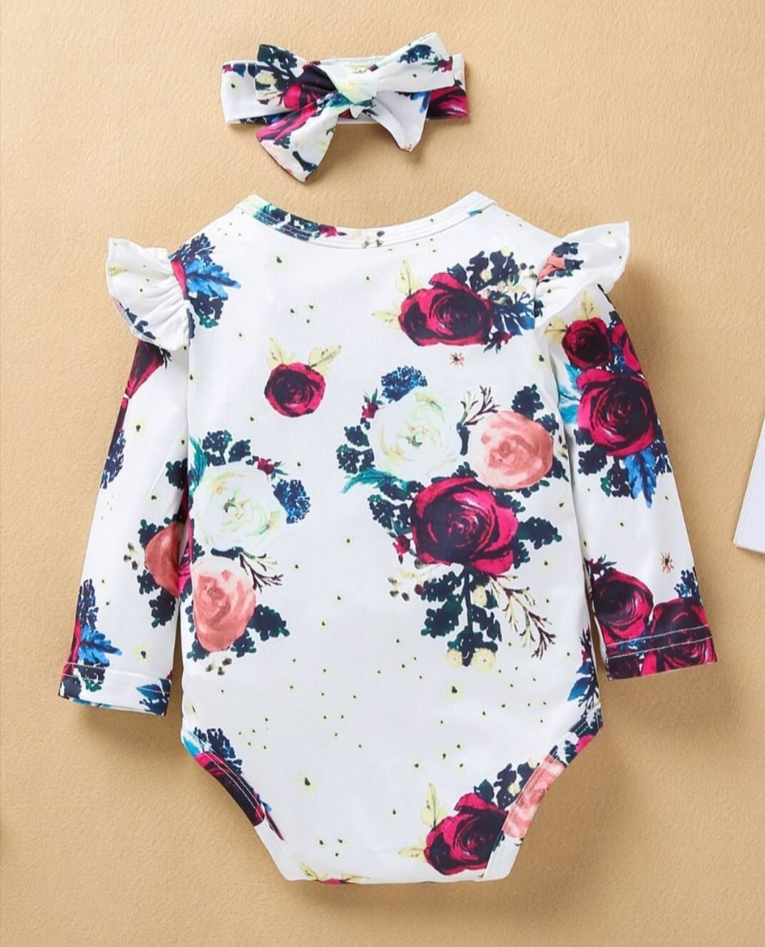 two piece floral bodysuit with matching headband for baby girl
