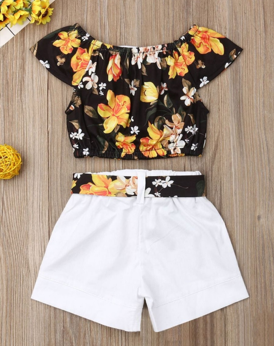 two piece set floral top and white belted shorts